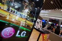 The LG Electronics Inc. logo is displayed on a television screen at the company's Bestshop store in the Gangnam district of Seoul, South Korea in July 2014. Photo credit: Bloomberg