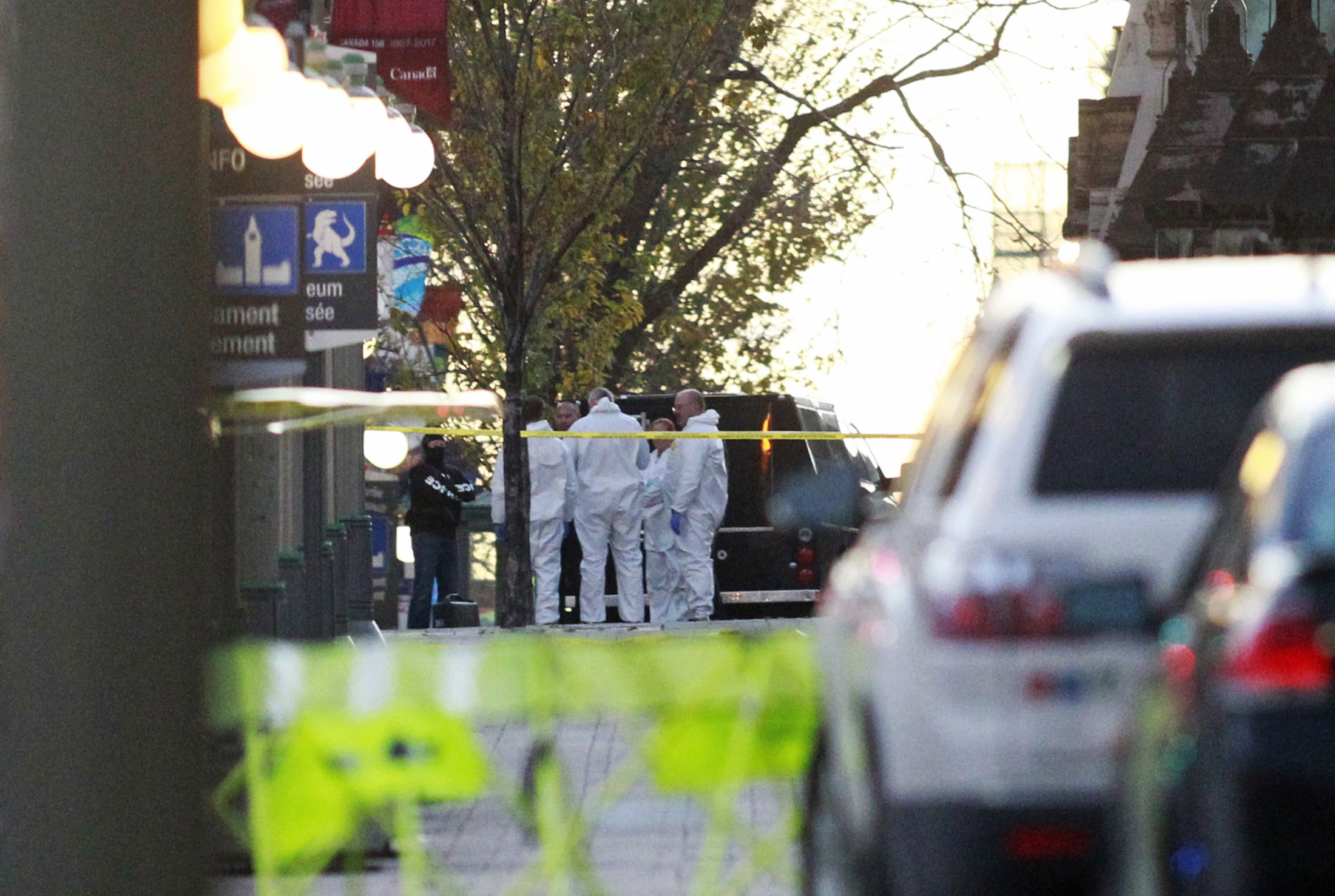 Ottawa pushes for business as usual after shootings
