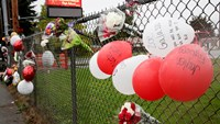 A makeshift memorial is seen outside Marysville-Pilchuck High School the day after a school shooting in Marysville, Washington October 25, 2014. Photo credit: Reuters