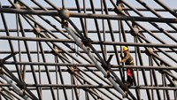 A worker welds steel bars during construction of the roof of a new railway station in Urumuqi, Xinjiang Uighur Autonomous region October 12, 2014. Photo credit: Reuters