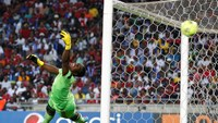 Goalkeeper Senzo Meyiwa of South Africa's Orlando Pirates fails to save a goal by Mohamed Aboutrika of Egypt's Al Ahli during the first leg of their African Champions League final soccer match at Orlando Stadium in Soweto, in this November 2, 2013 file pi
