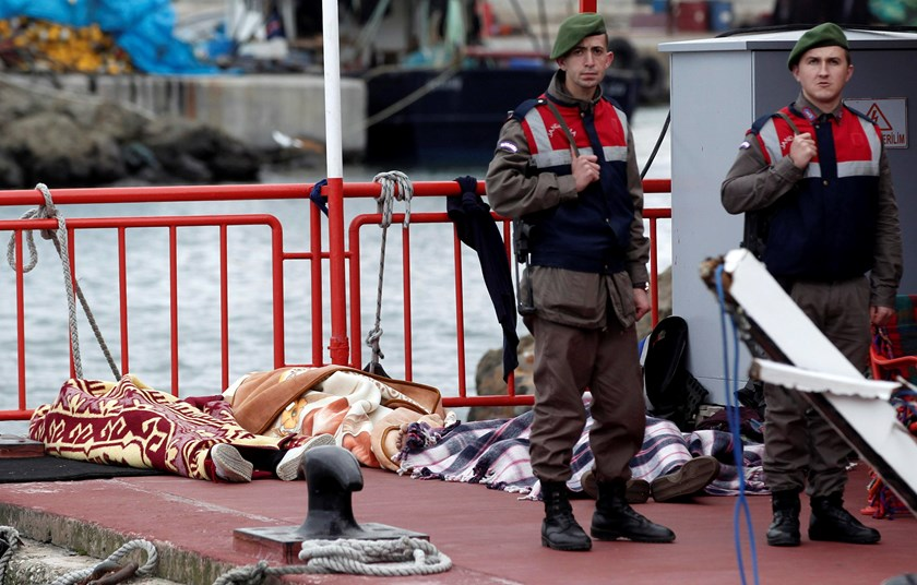 Turkish gendarmes stand next to bodies retrieved from the sea after a boat sank in the Bosphorus strait, in the Black Sea village of Garipce near Istanbul November 3, 2014. Photo credit: Reuters