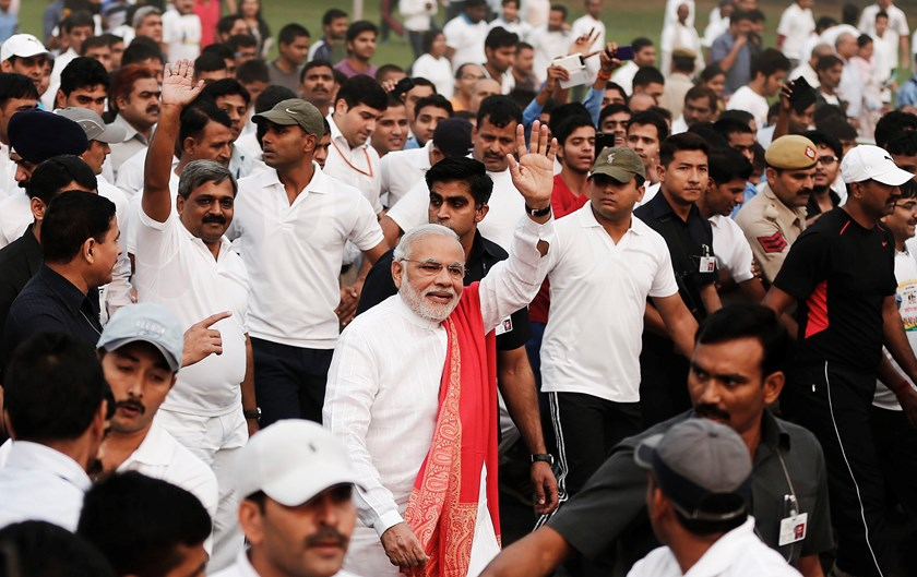 Indian Prime Minister Narendra Modi (C, wearing orange shawl) waves as he takes part in a run for unity after flagging it off to mark the birth anniversary of Indian freedom fighter and a lawmaker Sardar Vallabhbhai Patel, in New Delhi October 31, 2014. P