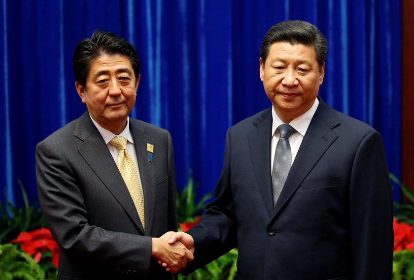 China's President Xi Jinping (R) shakes hands with Japan's Prime Minister Shinzo Abe during their meeting at the Great Hall of the People, on the sidelines of the Asia Pacific Economic Cooperation (APEC) meetings, in Beijing November 10, 2014. Photo credi