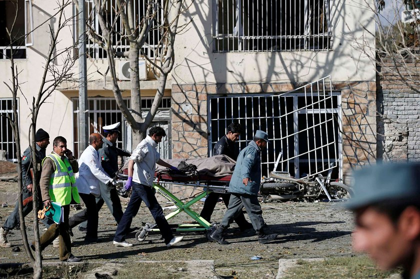 Officials carry a dead body on a stretcher at the site of a blast in Kabul November 16, 2014. An outspoken Afghan female lawmaker survived the suicide attack on her vehicle on Sunday but three civilian bystanders were killed, a police spokesman said. Phot