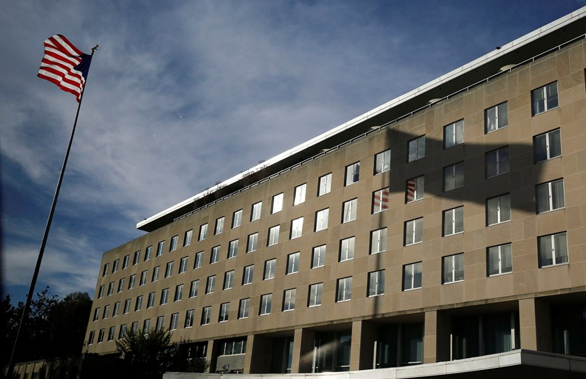 A U.S. national flag and its shadow on the Harry S. Truman Building at the Department of State are pictured in Washington, in this October 24, 2014 file photo. Photo credit: Reuters