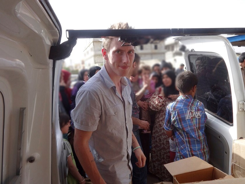 Abdul-Rahman (Peter) Kassig is pictured making a food delivery to refugees in Lebanon�s Bekaa Valley in this May 2013 handout photo. Photo credit: Reuters