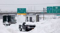 Vehicles litter the highway in West Seneca, New York November 19, 2014. An autumn blizzard dumped a year's worth of snow on western New York state where five people died and residents, some stranded overnight in cars, braced for another pummelling expecte