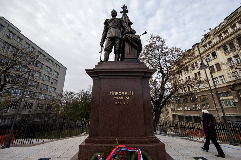 A woman walks past a statue of Czar Nicholas II of Russia, outside the Serbian presidency building in Belgrade, November 27, 2014. Photo credit: Reuters