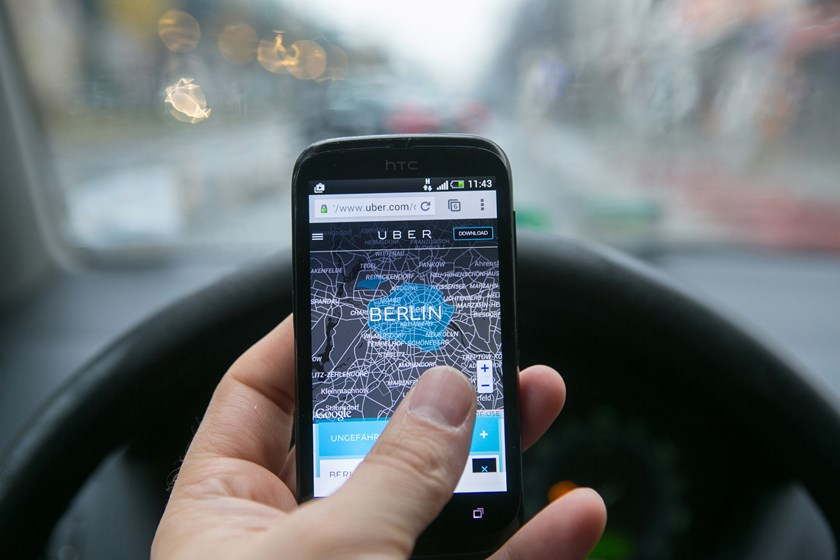 A HTC Corp. smartphone displays a city map of Berlin in the driver's seat of an automobile in this arranged photograph in Berlin, Germany, on Monday, Nov. 24, 2014. Photo credit: Bloomberg