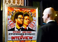 "A security guard stands at the entrance of United Artists theater during the premiere of the film ""The Interview"" in Los Angeles, California in this December 11, 2014 file photo. Photo credit: Reuters"