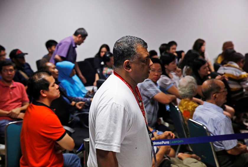 AirAsia CEO Tony Fernandes walks in front of family members of passengers onboard the missing AirAsia Flight QZ8501 at a news conference in Juanda International Airport, Surabaya December 28, 2014. Photo credit: Reuters