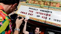 "ckets for the film ""The Interview"" is seen held up by theater manager Donald Melancon for the media at Crest Theater in Los Angeles, California December 24, 2014. Photo credit: Reuters"