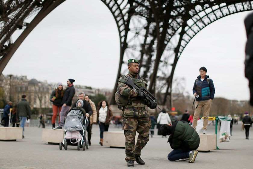 "A French soldier patrols near the Eiffel Tower as part of the highest level of ""Vigipirate"" security plan after a shooting at the Paris offices of Charlie Hebdo January 12, 2015. Photo credit: Reuters"