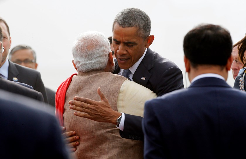 U.S. President Barack Obama hugs India's Prime Minister Narendra Modi as he arrives at Air Force Station Palam in New Delhi January 25, 2015. Photo credit: Reuters