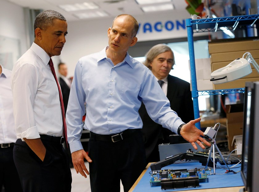 U.S. President Barack Obama (L) listens to engineer Rod Washington as he tours Vacon, a company that manufactures AC drives, during a visit to Raleigh, North Carolina, in this January 15, 2014 file photo. Photo credit: Reuters