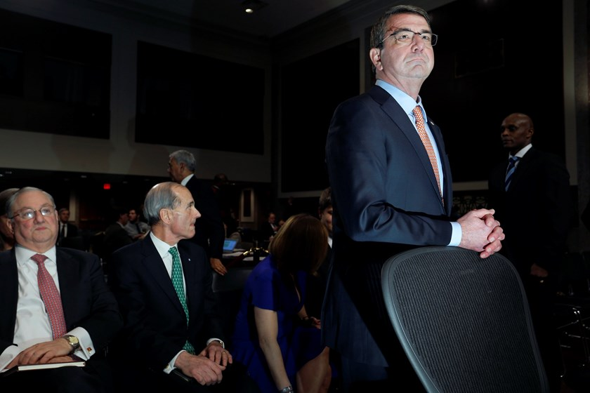 Ashton Carter (R), U.S. President Barack Obama's nominee to be secretary of defense, waits for the end of a lunch break to resume his testimony before a Senate Armed Services Committee confirmation hearing on Capitol Hill in Washington, February 4, 2015.