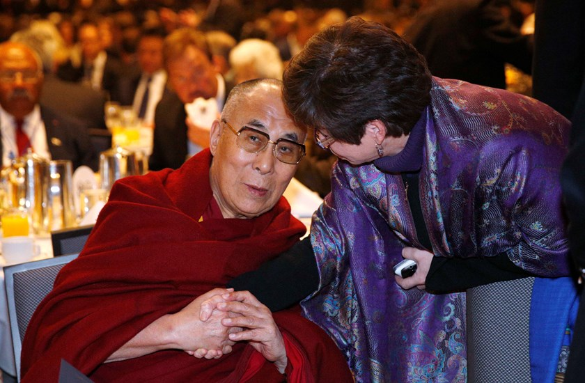 The Dalai Lama shakes hands with Valerie Jarrett, senior advisor to U.S. President Barack Obama, at the National Prayer Breakfast in Washington, February 5, 2014. Photo credit: Reuters