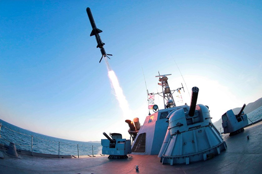 A missile is fired from a naval vessel during the test-firing of a new type of anti-ship cruise missile to be equipped at Korean People's Army (KPA) naval units in this undated photo released by North Korea's Korean Central News Agency (KCNA) in Pyongyang