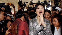 Ousted former Thai Prime Minister Yingluck Shinawatra gives a traditional greeting as she leaves parliament after delivering a statement during the National Legislative Assembly meeting in Bangkok, in this January 22, 2015 file photo. Photo credit: Reuter