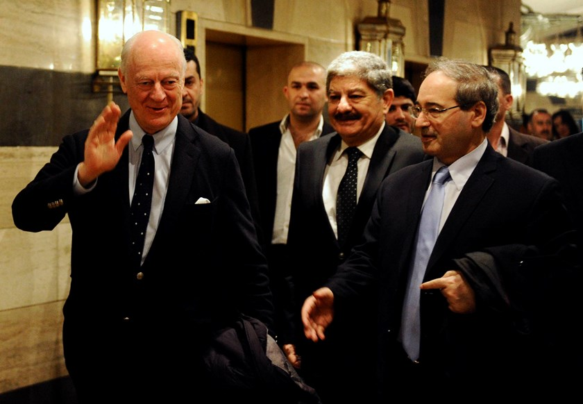 United Nations Special Envoy for Syria Staffan de Mistura (L) gestures as he walks with Syria's Deputy Foreign Minister Faisal al-Miqdad (R) upon his arrival at a hotel in Damascus February 9, 2015. Photo credit: Reuters
