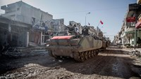 Turkish tanks are pictured in the northern Syrian town of Kobani as they return from a military operation inside Syria February 22, 2015. Photo credit: Reuters