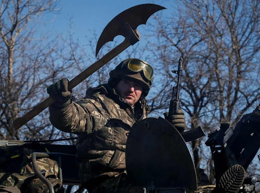 member of the Ukrainian armed forces rides an armoured personnel carrier near Artemivsk, eastern Ukraine, February 22, 2015. Photo credit: Reuters