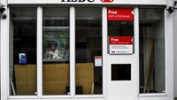 orkers carry out maintenance at a 'hole in the wall' cash dispenser at a branch of HSBC in London February 22, 2015. Photo credit: Reuters