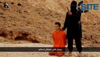 A masked, black-clad militant, who has been identified by the Washington Post newspaper as a Briton named Mohammed Emwazi, stands next to a man purported to be Kenji Goto in this still image from a video obtained from SITE Intel Group website February 26,