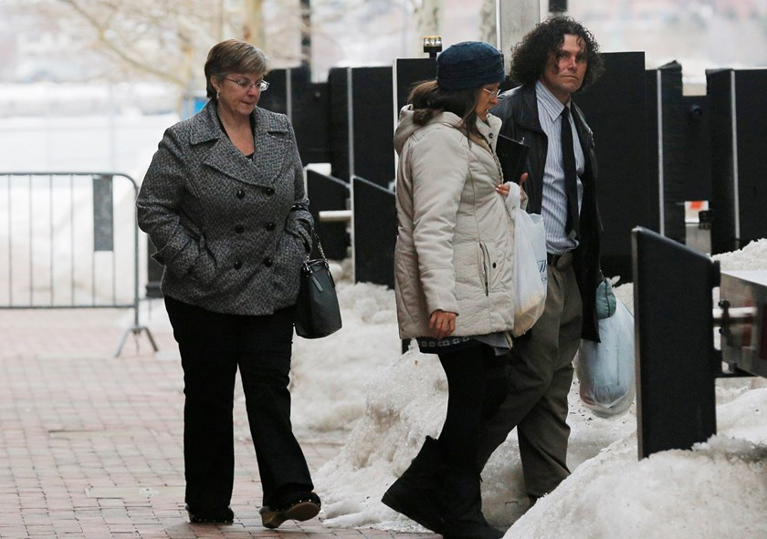 Boston Marathon bombing survivor Karen Brassard (L) and bombing witness Carlos Arredondo (R) leave the federal courthouse after the second day of the trial of accused bomber Dzhokhar Tsarnaev in Boston, Massachusetts March 5, 2015. Photo credit: Reuters