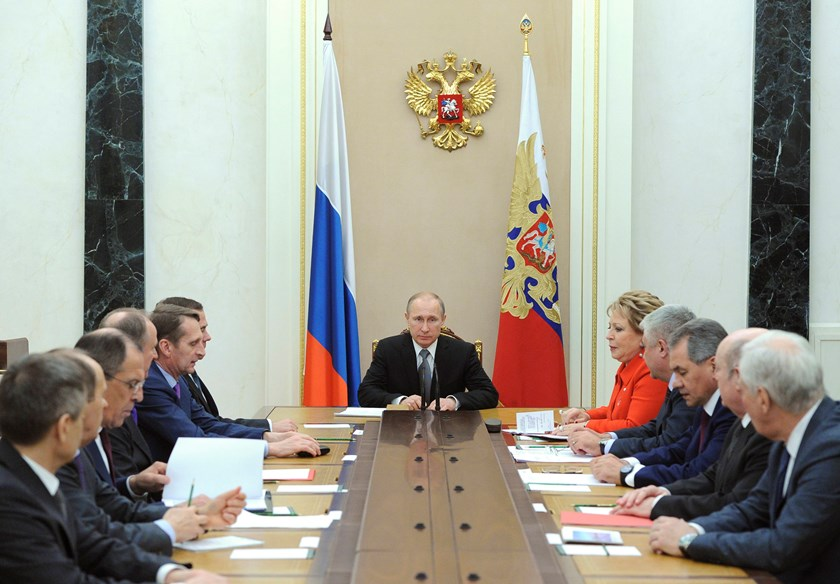 Russian President Vladimir Putin (C) chairs a meeting with members of the Security Council at the Kremlin in Moscow March 6, 2015. Photo credit: Reuters