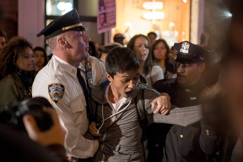 A protester is detained by New York City police officers (NYPD) during a demonstration calling for social, economic and racial justice in New York May 1, 2015. Photo: Reuters