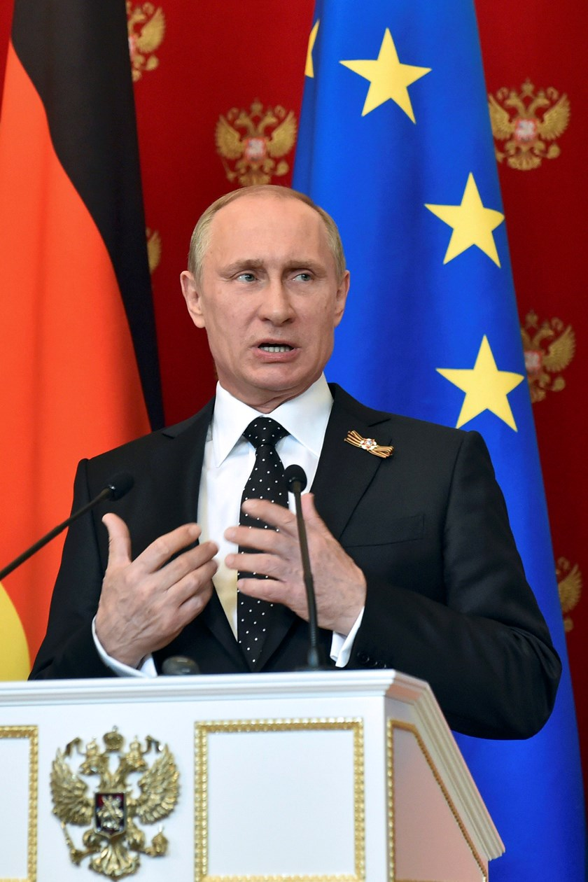 Russian President Vladimir Putin speaks during a news conference after talks with German Chancellor Angela Merkel at the Kremlin in Moscow, Russia, May 10, 2015. Photo: Reuters