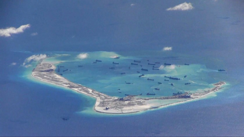 Chinese dredging vessels are purportedly seen in the waters around Mischief Reef in the disputed Spratly Islands in the South China Sea, in this file still image from video taken by a P-8A Poseidon surveillance aircraft and provided by the United States N