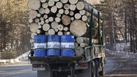 A truck carries wood and Gazprom Neft branded oil barrels along the M54 federal highway south of Siberian city of Krasnoyarsk, Russia in this February 21, 2015 file photo. Photo: Reuters