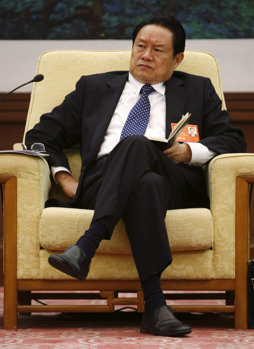 hen China's Public Security Minister Zhou Yongkang attends a meeting in Beijing in this October 16, 2007 file picture. Photo credit: Reuters