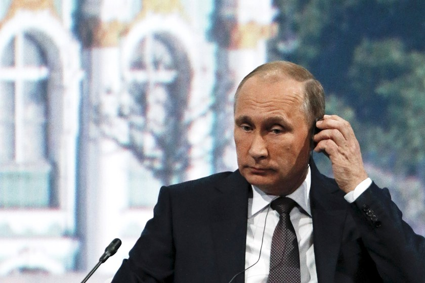 Russian President Vladimir Putin adjusts his earphones during a session of the St. Petersburg International Economic Forum 2015 (SPIEF 2015) in St. Petersburg, Russia, June 19, 2015.  Photo: Reuters