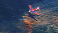 The crew of a Basler BT-67 fixed wing aircraft release oil dispersant over an oil discharge from the mobile offshore drilling unit, Deepwater Horizon, off the shore of Louisiana, in this May 5, 2010 handout photograph. Photo: Reuters