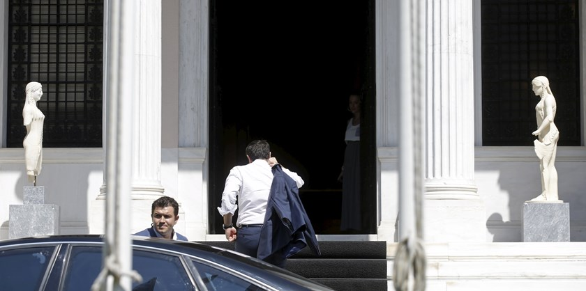 Greek Prime Minister Alexis Tsipras arrives at his office in Maximos Mansion in Athens, Greece, July 13, 2015.  Photo: Reuters