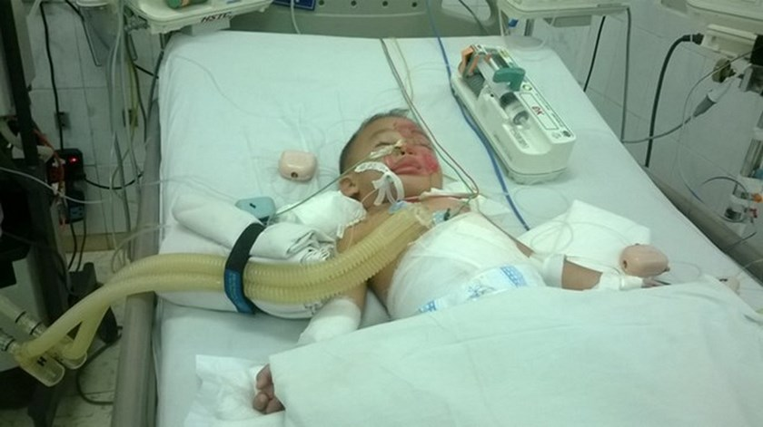 Three-year-old Pham Hoang Thien Hoa remains in critical condition after three days in the hospital.