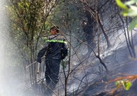A fireman works at the scene of a fire in the Ba Na moutain,Da Nang city.