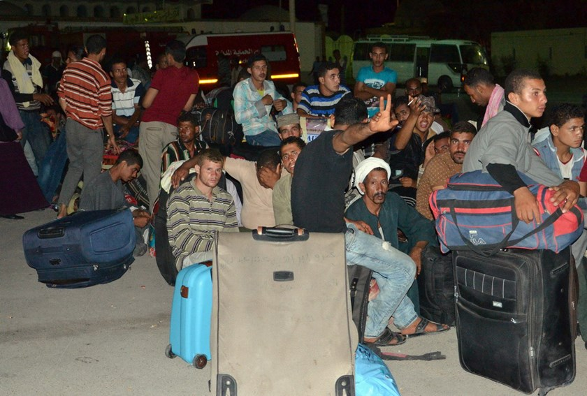 Egyptians rest on August 4 after crossing Ras Jedir' border, in Tunisia, to flee from clashes in Lybia. Photo: AFP