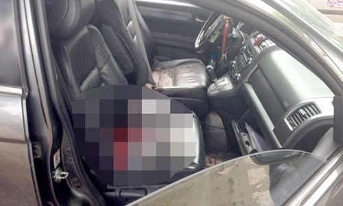 The scene inside a car where Kieu Ngoc Thanh, 55, was killed last Tuesday. Photo courtesy of the polic