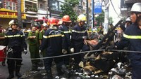 Firemen at the scene of a blaze that broke out early Tuesday morning in Ho Chi Minh City. Photo: Cong Nguyen