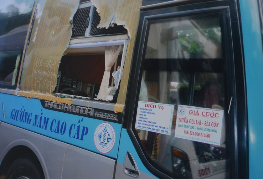 A bus window was broken after a local man threw at the vehicle while it was in motion. Photo: Tran Hieu