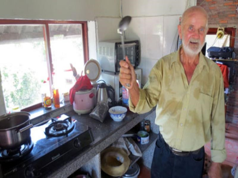 Kurt Lender Jensen in his kitchen on September 30, 2014 waiting to enjoy the bun bo Hue being cooked by his wife. Photo: Que Ha