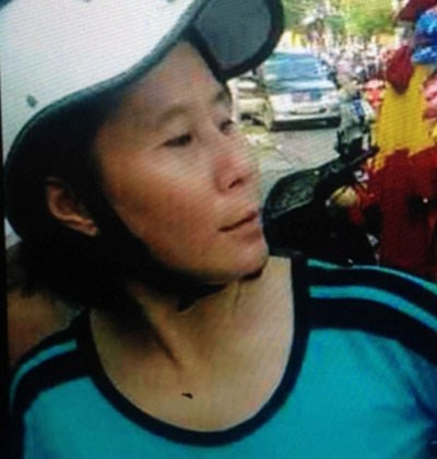 Nguyen Thi Loan, 42, is arrested on Thursday morning for kidnapping a three-year old girl in Ho Chi Minh City. Photo handout by HCMC police