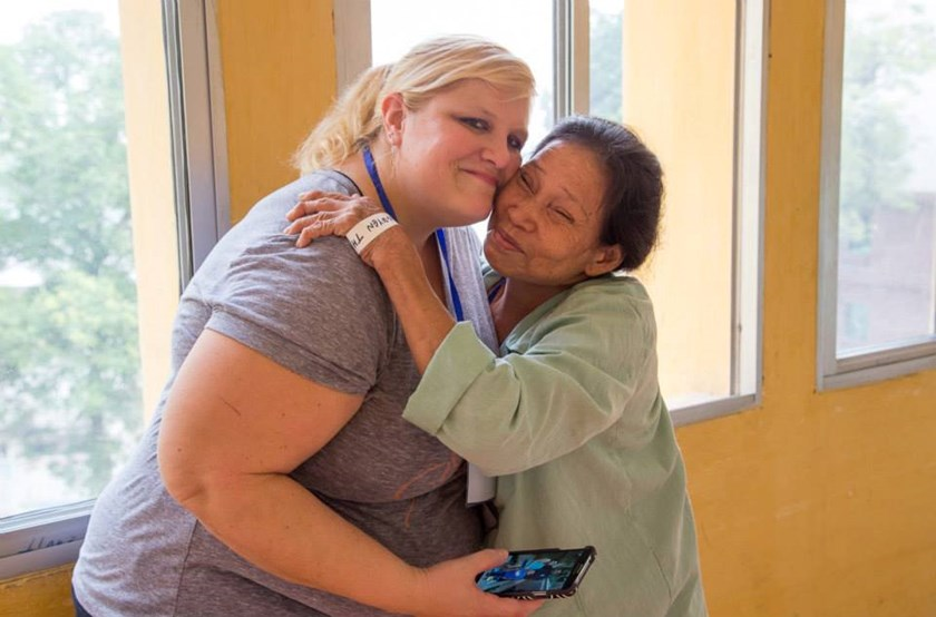 Michelle Burdette, a nurse volunteer with Operation Walk, gets a hug from Nho Nguyen after she found out her surgery date. Photo courtesy of Operation Walk