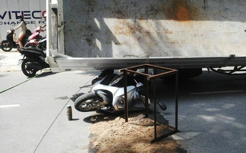 A crane suddenly flipped over on Friday morning in Ho Chi Minh City, crushing a motorist's bike, but sparing his life. File photo