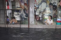 Saigon streets flooded after downpour, again